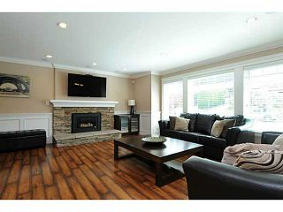 Photo 5: 869 RUNNYMEDE Avenue in Coquitlam: Coquitlam West House for sale : MLS®# V1064519