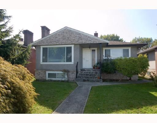 "Main Photo: 2266 E 1ST Avenue in Vancouver: Grandview VE House for sale in ""COMMERCIAL DR."" (Vancouver East)  : MLS®# V795955"
