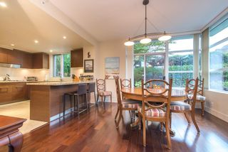 "Photo 1: 107 6018 IONA Drive in Vancouver: University VW Townhouse for sale in ""Argyll House West"" (Vancouver West)  : MLS®# R2000620"