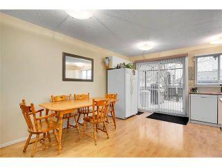 Photo 8: 1399 BERKLEY Drive NW in Calgary: Beddington Heights House for sale