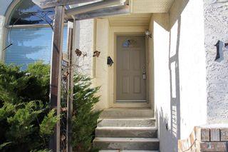 Photo 2: 17123 Sundown Road SE in Calgary: Sundance Detached for sale : MLS®# A1048128
