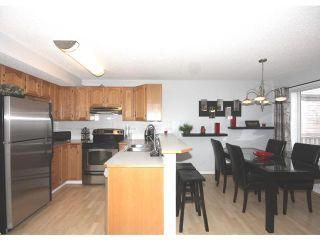 Photo 5: 252 HARVEST CREEK Court NE in CALGARY: Harvest Hills Residential Detached Single Family for sale (Calgary)  : MLS®# C3520986