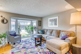 Photo 4: 202 19 Street NW in Calgary: West Hillhurst Semi Detached for sale : MLS®# A1129598