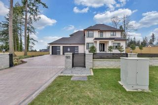 Photo 2: 5725 131A Street in Surrey: Panorama Ridge House for sale : MLS®# R2557701