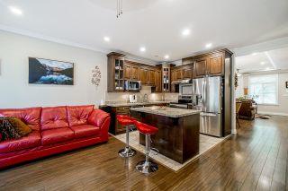 Photo 12: 6882 144 Street in Surrey: East Newton Condo for sale : MLS®# R2608297