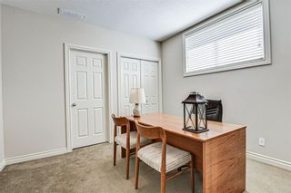 Photo 43: 7 ELYSIAN Crescent SW in Calgary: Springbank Hill Semi Detached for sale : MLS®# A1104538