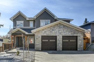 Main Photo: 907 31 Avenue NW in Calgary: Cambrian Heights Detached for sale : MLS®# A1095749