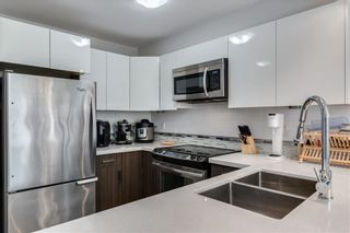 """Photo 4: 303 2408 E BROADWAY in Vancouver: Renfrew VE Condo for sale in """"BROADWAY CROSSING"""" (Vancouver East)  : MLS®# R2463724"""