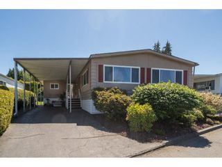 """Photo 1: 34 8254 134 Street in Surrey: Queen Mary Park Surrey Manufactured Home for sale in """"WESTWOOD ESTATES"""" : MLS®# R2586681"""