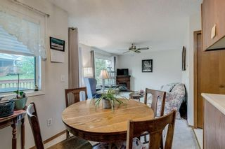 Photo 10: 71 Sandarac Circle NW in Calgary: Sandstone Valley Row/Townhouse for sale : MLS®# A1141051