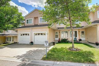 Photo 1: 154 388 Sandarac Drive NW in Calgary: Sandstone Valley Row/Townhouse for sale : MLS®# A1115422