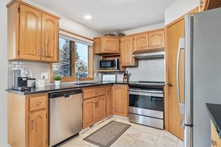 Photo 9: 92 Arbour Glen Close NW in Calgary: Arbour Lake Detached for sale : MLS®# A1066556