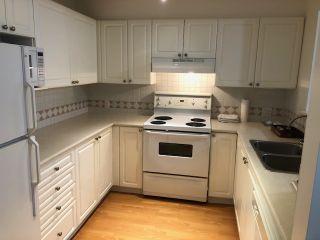 """Photo 2: 115 15268 105 Avenue in Surrey: Guildford Condo for sale in """"Georgian Gardens"""" (North Surrey)  : MLS®# R2499609"""