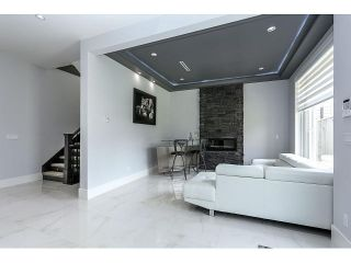 Photo 3: 4038 RUMBLE ST - LISTED BY SUTTON CENTRE REALTY in Burnaby: Suncrest House for sale (Burnaby South)  : MLS®# V1122974