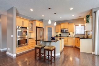 Photo 8: 131 Cougar Plateau Circle SW in Calgary: 2 Storey for sale : MLS®# C3614218