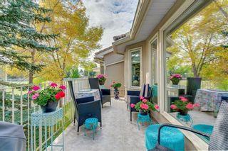 Photo 27: 66 GLENMORE Green SW in Calgary: Kelvin Grove Semi Detached for sale : MLS®# A1029652