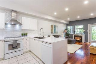 "Photo 1: 105 1591 BOOTH Avenue in Coquitlam: Maillardville Condo for sale in ""Le Laurentien"" : MLS®# R2361074"