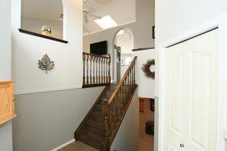 Photo 4: 306 WEST TERRACE Place: Cochrane House for sale : MLS®# C4117766