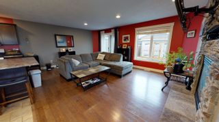 Photo 2: 11732 97 Street in Fort St. John: Fort St. John - City NE 1/2 Duplex for sale (Fort St. John (Zone 60))  : MLS®# R2611862