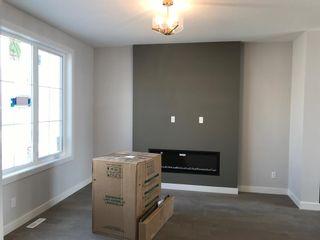 Photo 6: 23 Sunrise Heights: Cochrane Duplex for sale : MLS®# A1017998