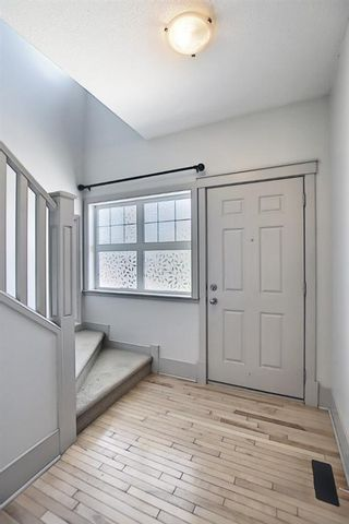 Photo 4: 63 Wentworth Common SW in Calgary: West Springs Row/Townhouse for sale : MLS®# A1124475