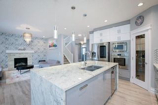 Photo 13: 48 Tremblant Terrace SW in Calgary: Springbank Hill Detached for sale : MLS®# A1131887