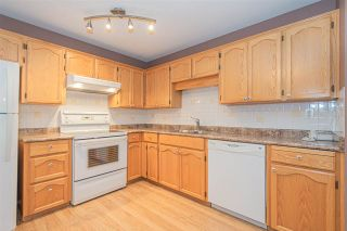 Photo 6: 106 20600 53A AVENUE in Langley: Langley City Condo for sale : MLS®# R2398486