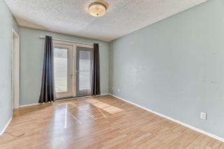 Photo 13: 316 Queen Alexandra Road SE in Calgary: Queensland Detached for sale : MLS®# A1104461