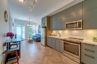 "Photo 2: 328 14968 101A Avenue in Surrey: Guildford Condo for sale in ""Mosaic Guildhouse"" (North Surrey)  : MLS®# R2603317"