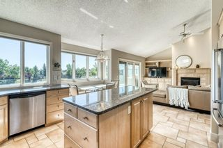 Photo 15: 555 Coach Light Bay SW in Calgary: Coach Hill Detached for sale : MLS®# A1144688