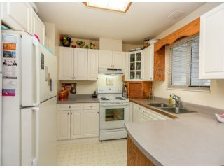 """Photo 7: 13564 87A Avenue in Surrey: Queen Mary Park Surrey House for sale in """"West Newton"""" : MLS®# F1322641"""
