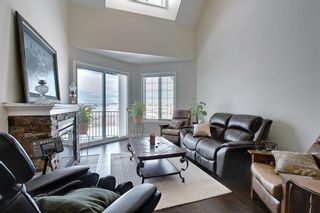 Photo 16: 2407 15 SUNSET Square: Cochrane Apartment for sale : MLS®# A1072593