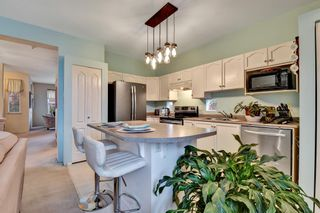 """Photo 13: 18452 67A Avenue in Surrey: Cloverdale BC House for sale in """"Clover Valley Station"""" (Cloverdale)  : MLS®# R2625017"""