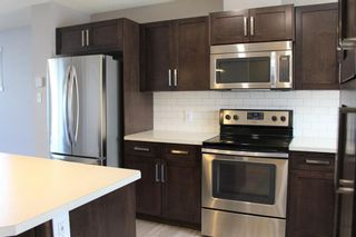 Photo 9: 1404 Clover Link: Carstairs Row/Townhouse for sale : MLS®# A1073804