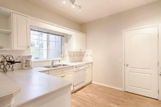 Photo 6: 301 PATTERSON View SW in Calgary: Patterson Row/Townhouse for sale : MLS®# A1062287