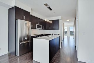 Photo 4: 1 3814 Parkhill Place SW in Calgary: Parkhill Row/Townhouse for sale : MLS®# A1121191