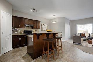Photo 4: 195 CRANFORD Crescent SE in Calgary: Cranston Detached for sale : MLS®# A1031321