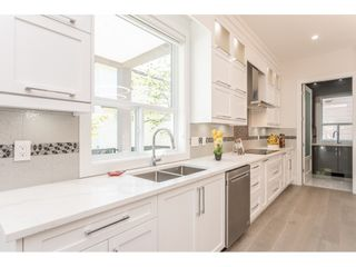 Photo 14: 12988 CARLUKE Crescent in Surrey: Queen Mary Park Surrey House for sale : MLS®# R2415665