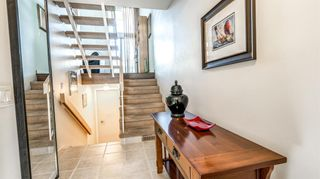 Photo 3: 22 10457 19 Street SW in Calgary: Braeside Row/Townhouse for sale : MLS®# A1074324