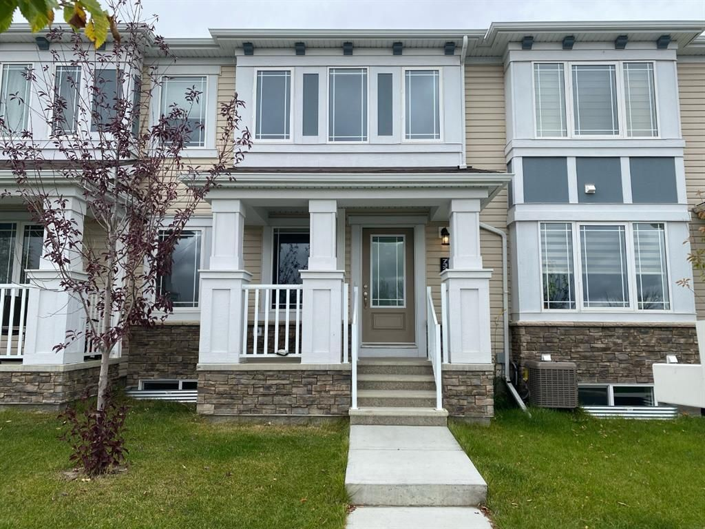 Main Photo: 732 Osborne Drive SW: Airdrie Row/Townhouse for sale : MLS®# A1133429