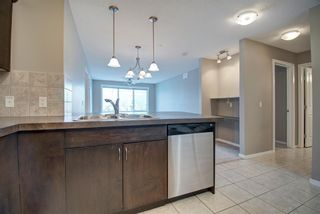 Photo 3: 1207 4 Kingsland Close SE: Airdrie Apartment for sale : MLS®# A1062903