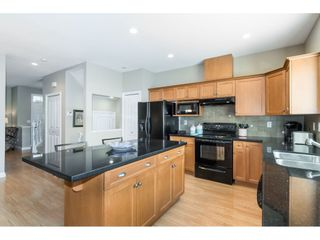 """Photo 9: 7033 179A Street in Surrey: Cloverdale BC Condo for sale in """"Provinceton"""" (Cloverdale)  : MLS®# R2392761"""