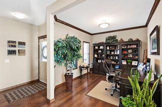 Photo 3: 124 Tremblant Way SW in Calgary: Springbank Hill Detached for sale : MLS®# A1088051