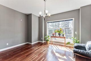 Photo 4: 702 69 Avenue SW in Calgary: Kingsland Semi Detached for sale : MLS®# A1081661