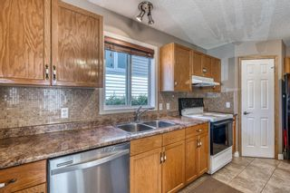Photo 12: 97 Arbour Wood Mews NW in Calgary: Arbour Lake Detached for sale : MLS®# A1119755
