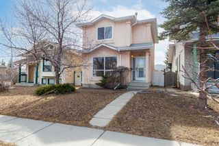 Photo 1: 887 Erin Woods Drive SE in Calgary: Erin Woods Detached for sale : MLS®# A1099055