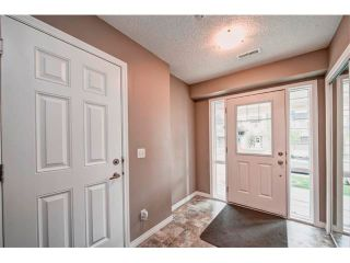 Photo 3: 113 WINDSTONE Mews SW: Airdrie House for sale : MLS®# C4016126