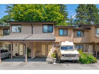 """Photo 1: 103 7349 140 Street in Surrey: East Newton Townhouse for sale in """"Newton Park"""" : MLS®# R2464654"""