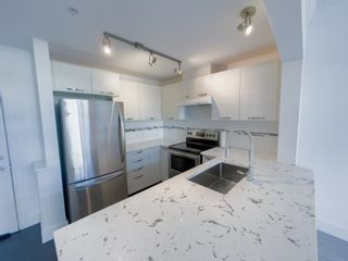 """Photo 3: 405 7478 BYRNEPARK Walk in Burnaby: South Slope Condo for sale in """"GREEN"""" (Burnaby South)  : MLS®# R2615130"""