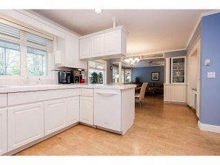 Photo 7: 15686 90A Avenue in Surrey: Fleetwood Tynehead House for sale : MLS®# F1411061
